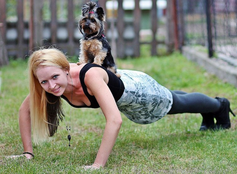 Blonde woman training with a Yorkie